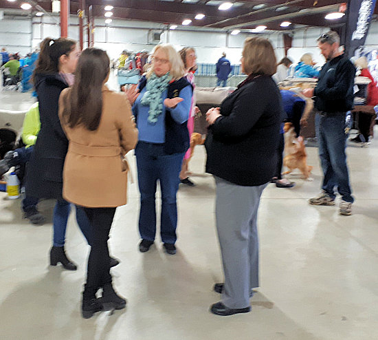 Club Chair Kim chats to a CKC representative and two students from a marketing class about the world of purebred dogs